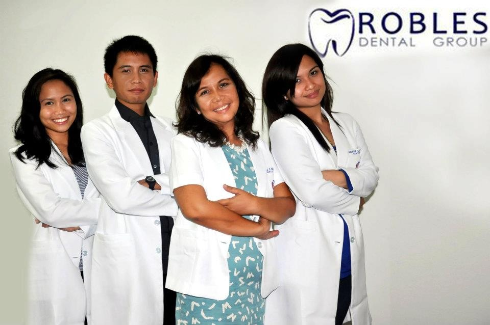 Dra Annabelle Robles with her children, all dentists
