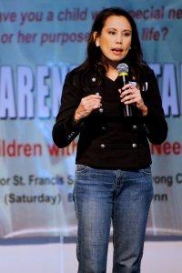 Malu speaking at a Parenting Seminar