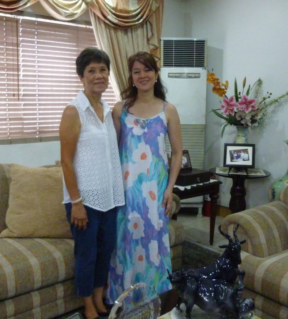 I'm wearing one of my favorite Beso sundresses while visiting with my cousin-in-law, Achi Maribel