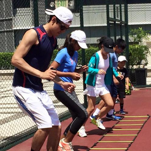 Perkins Twins Tennis Academy on the tennis courts of edsa shangrila