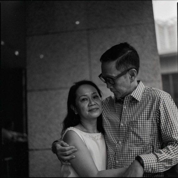 The look of love from Francis Kong to his beloved wife, Lilia.