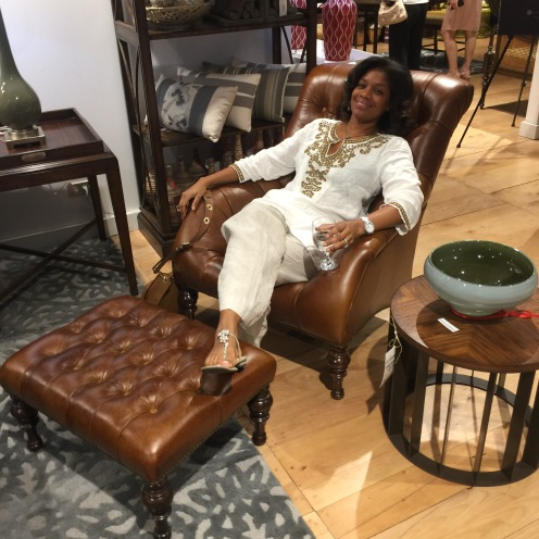 Cindy Porter enjoying the comfy leather quilted armchair.