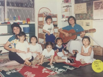 Teacher Fe singing with the young children